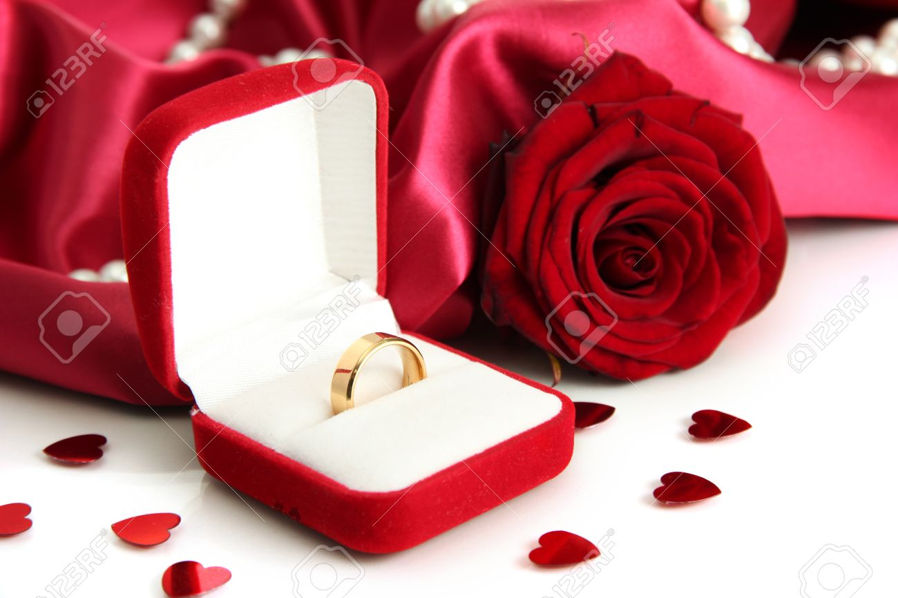 67a2ce9ad Beautiful box with wedding ring and rose on red silk background Stock Photo  - 18117480