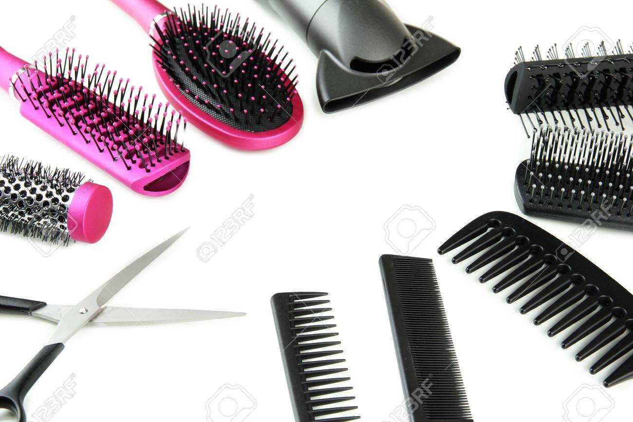 Comb brushes, hairdryer and cutting shears, isolated on white Stock Photo - 18322790