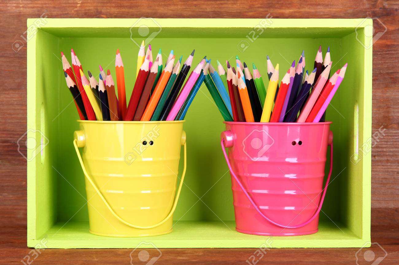 Colorful pencils in pails on shelf on wooden background Stock Photo - 18323242