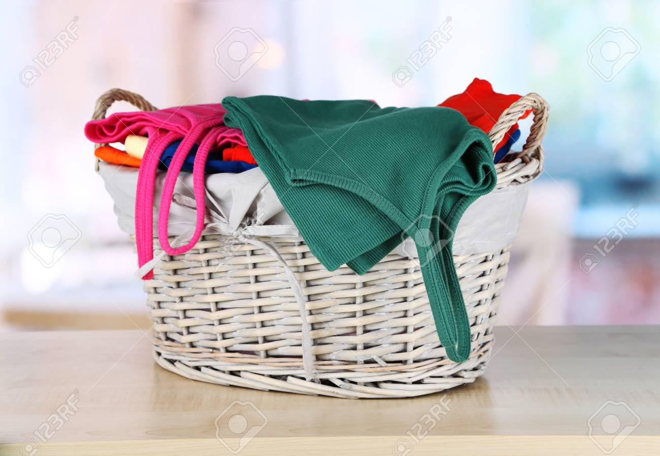 Clothes in wooden basket on table in room Stock Photo - 18473004