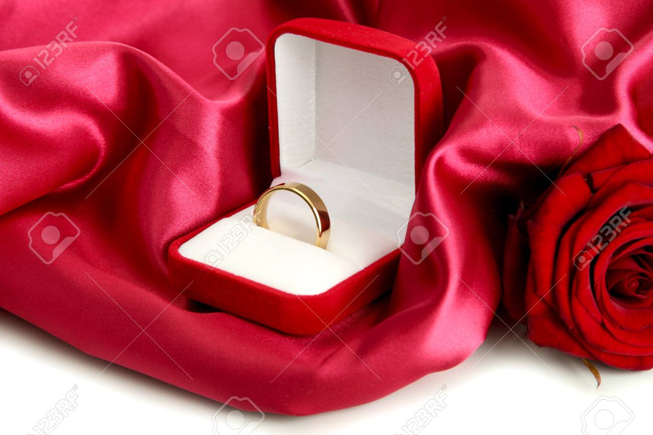 59ef4e699 Beautiful box with wedding ring and rose on red silk background Stock Photo  - 18579897