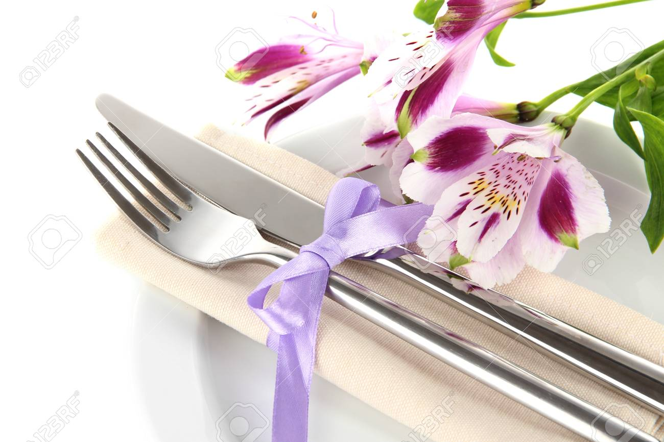 Festive dining table setting with flowers isolated on white Stock Photo - 18763996