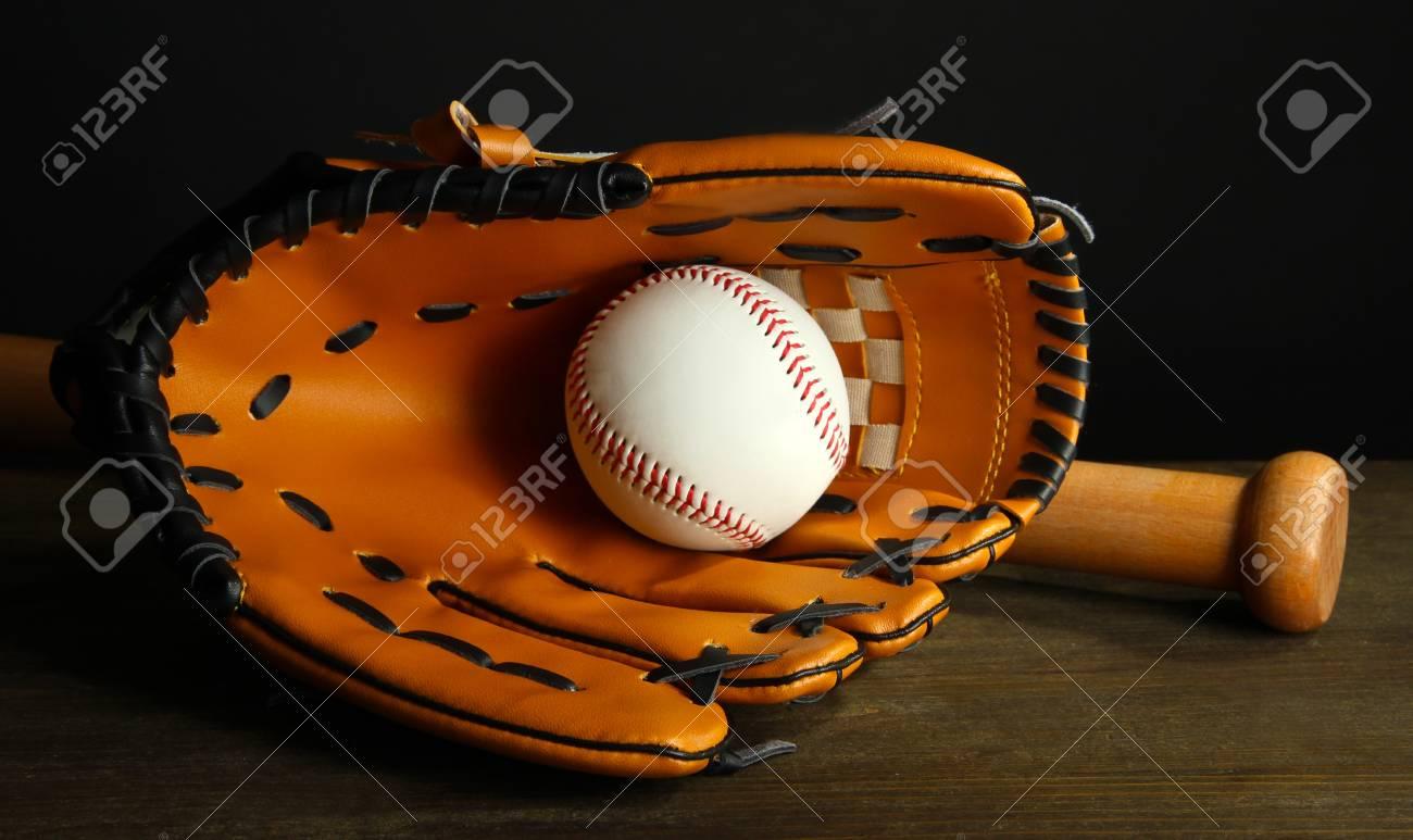 Baseball glove, bat and ball on dark background Stock Photo - 18716419