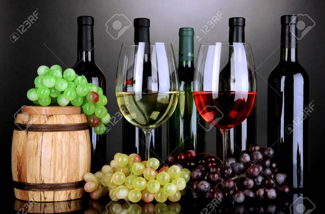 Assortment of wine in glasses and bottles on grey background Stock Photo - 18717653