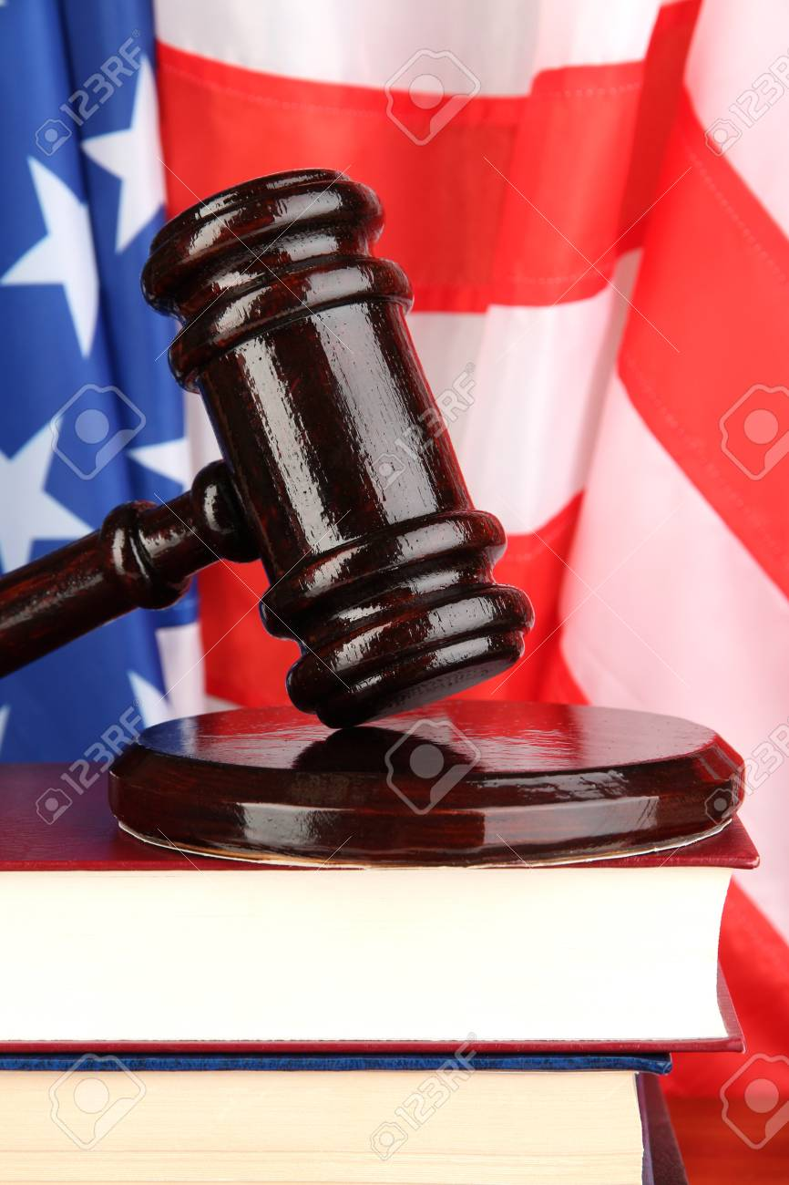Judge gavel and books on american flag background Stock Photo - 18717652