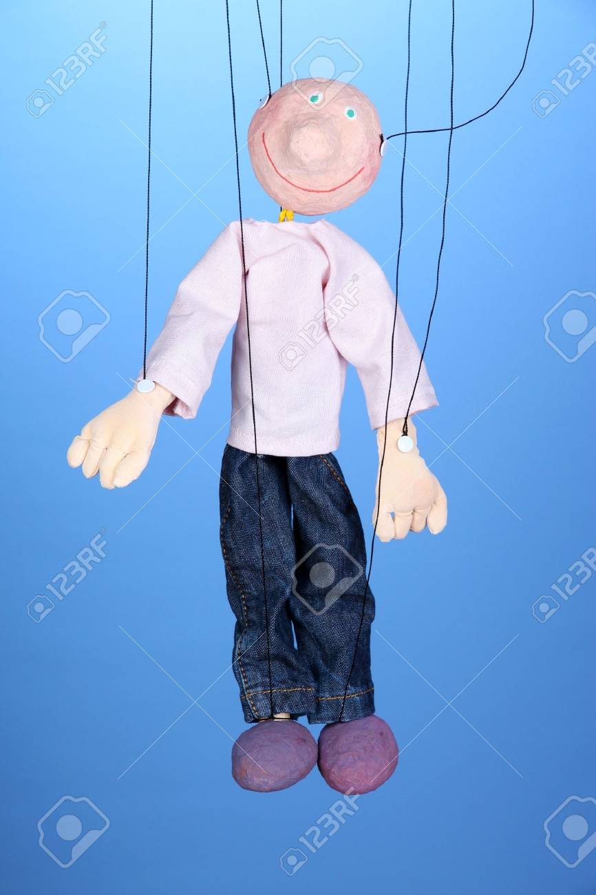 Wooden puppet on blue background Stock Photo - 18776610