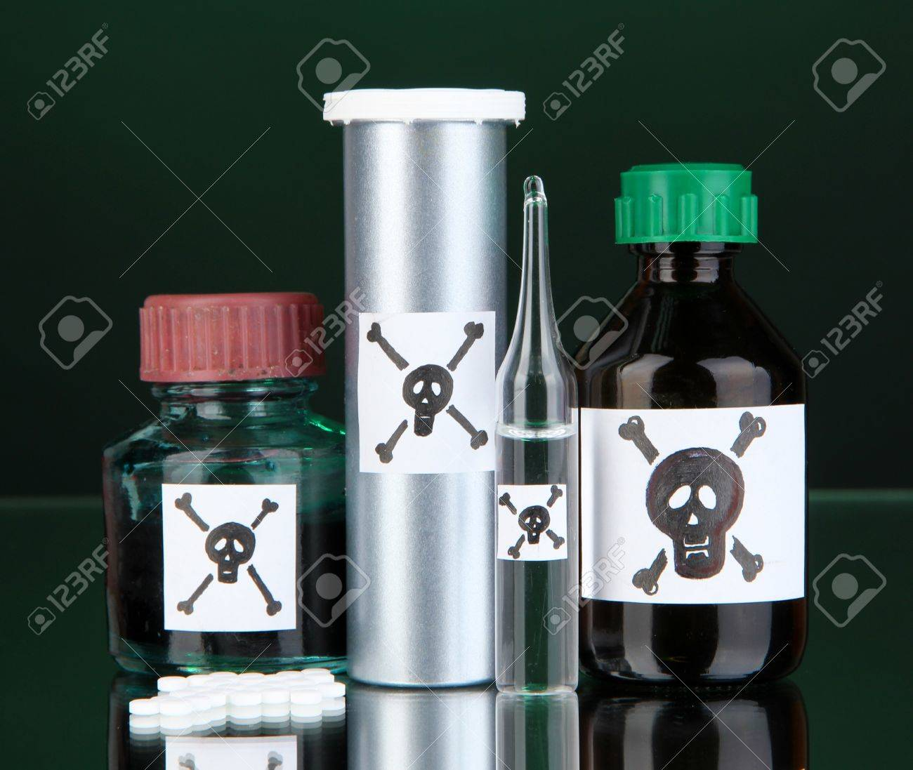Deadly poison in bottles on black background Stock Photo - 18800681