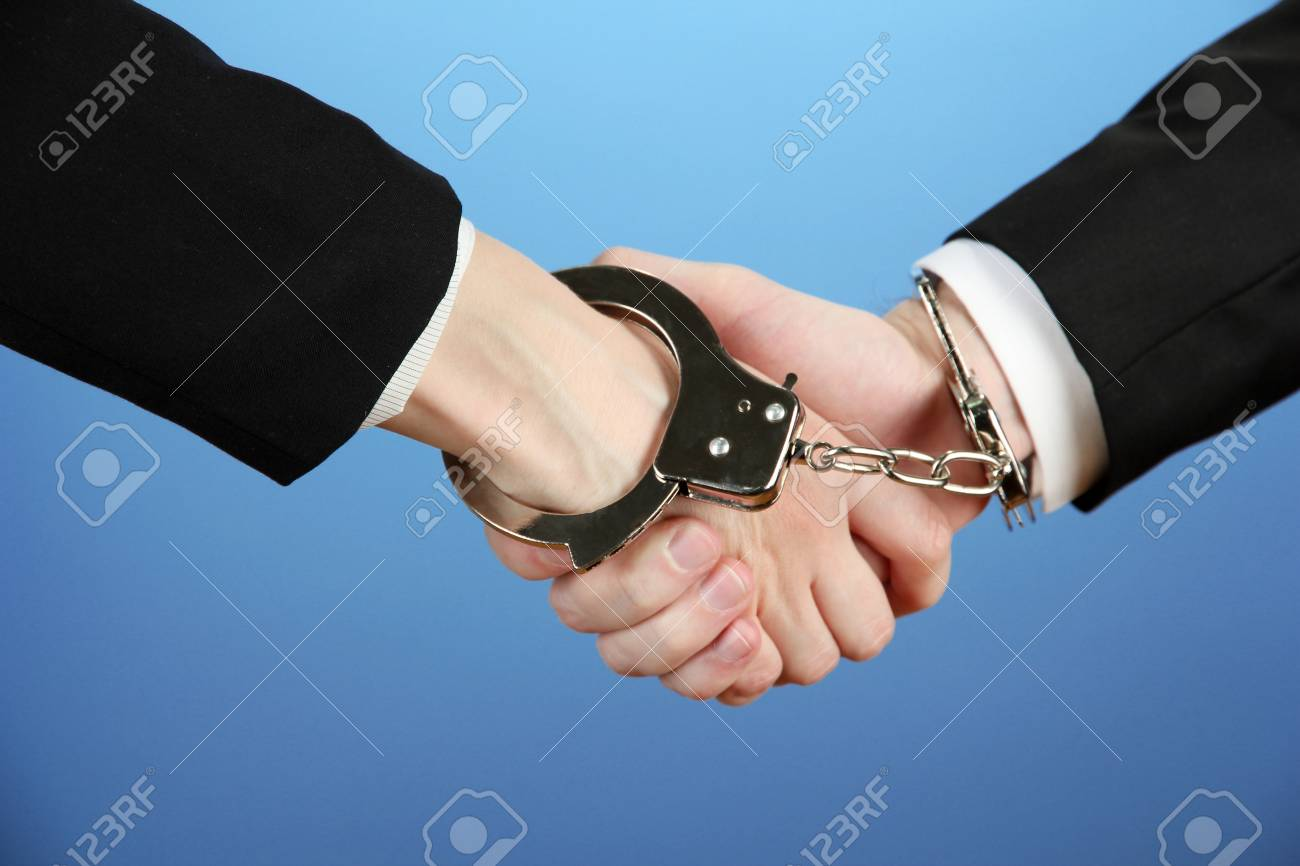 Man and woman hands and breaking handcuffs on color background Stock Photo - 18891987