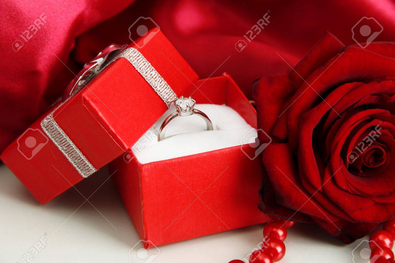 08730e304 Beautiful box with wedding ring and rose on red silk background Stock Photo  - 19099206