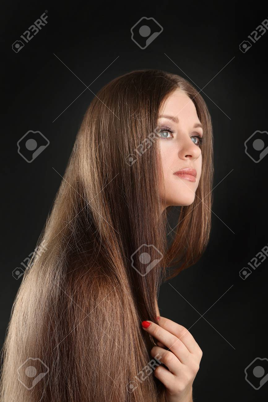 Portrait of beautiful woman with long hair on black background Stock Photo - 19361182