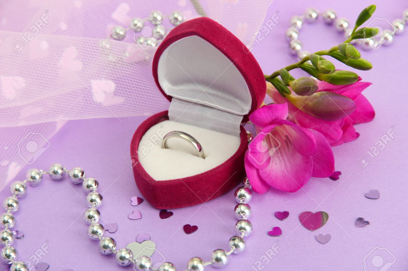 Beautiful Box With Wedding Ring And Flower On Purple Background ...