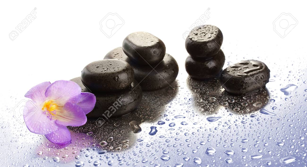 Spa stones and purple flower, isolated on white Stock Photo - 19289508