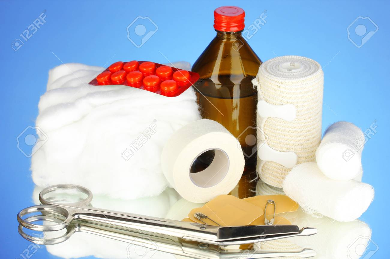 First aid kit for bandaging on blue background Stock Photo - 19278088
