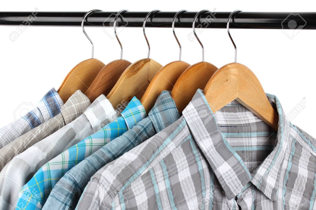 Shirts with ties on wooden hangers isolated on white Stock Photo - 19385227