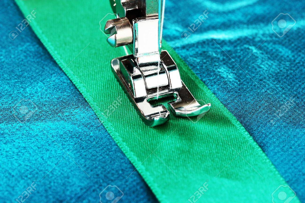 Closeup of sewing machine working part with  blue cloth Stock Photo - 19510666