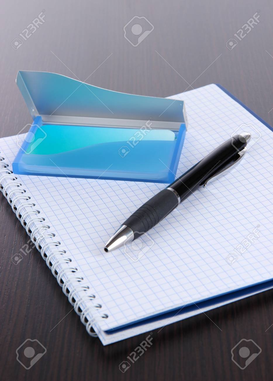 Blue Business Card Holder Notebook And Pen Close Up Stock Photo