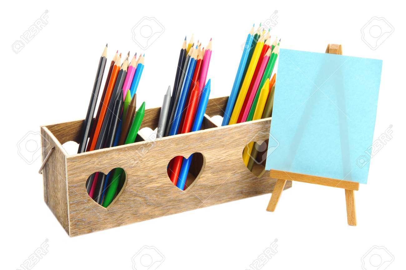 Different pencils in wooden crate and easel, isolated on white Stock Photo - 19988695