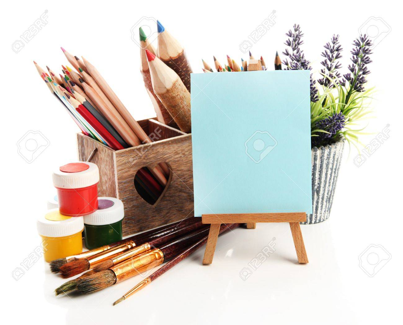 Pencils in wooden crate, paints, brushes and easel, isolated on white Stock Photo - 19988748