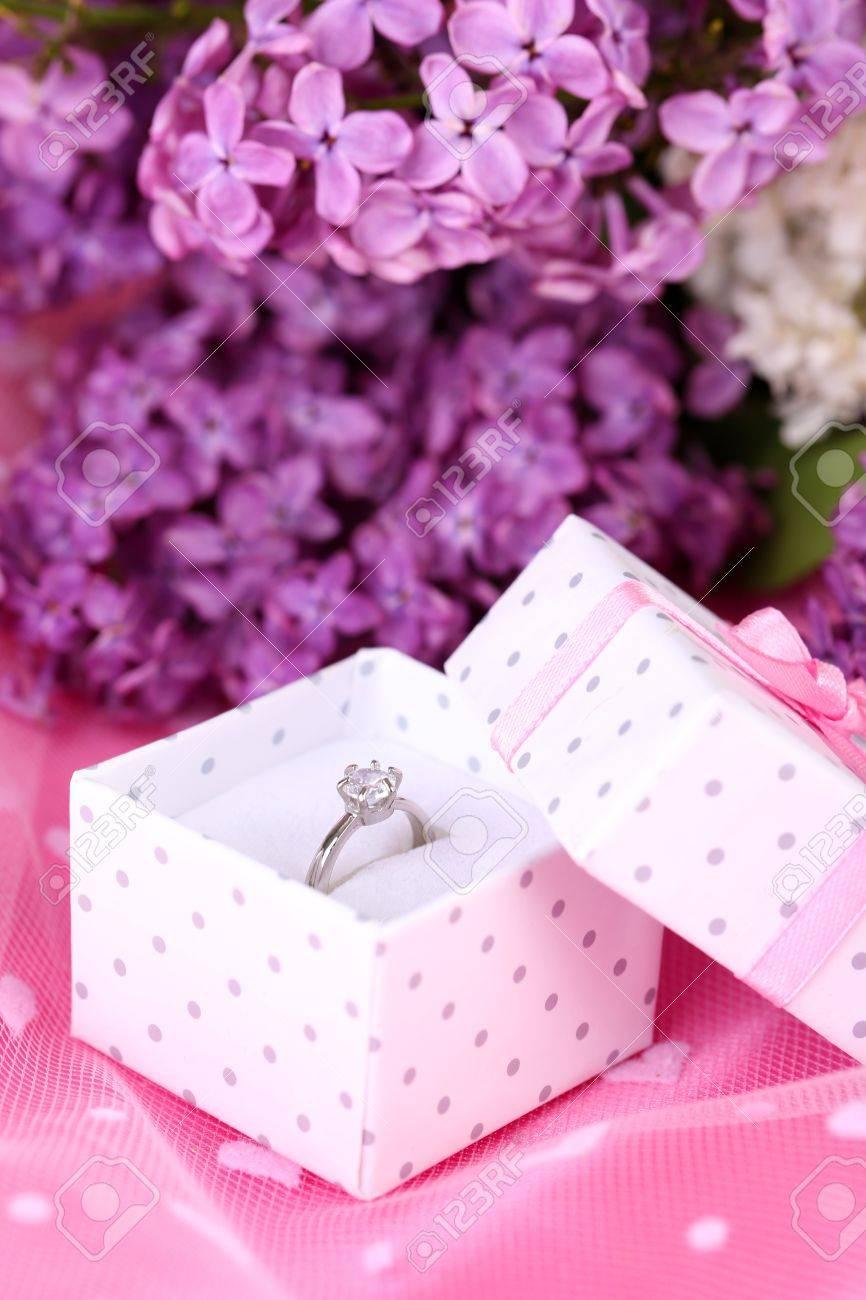 Beautiful Box With Wedding Ring On Purple Background Stock Photo ...