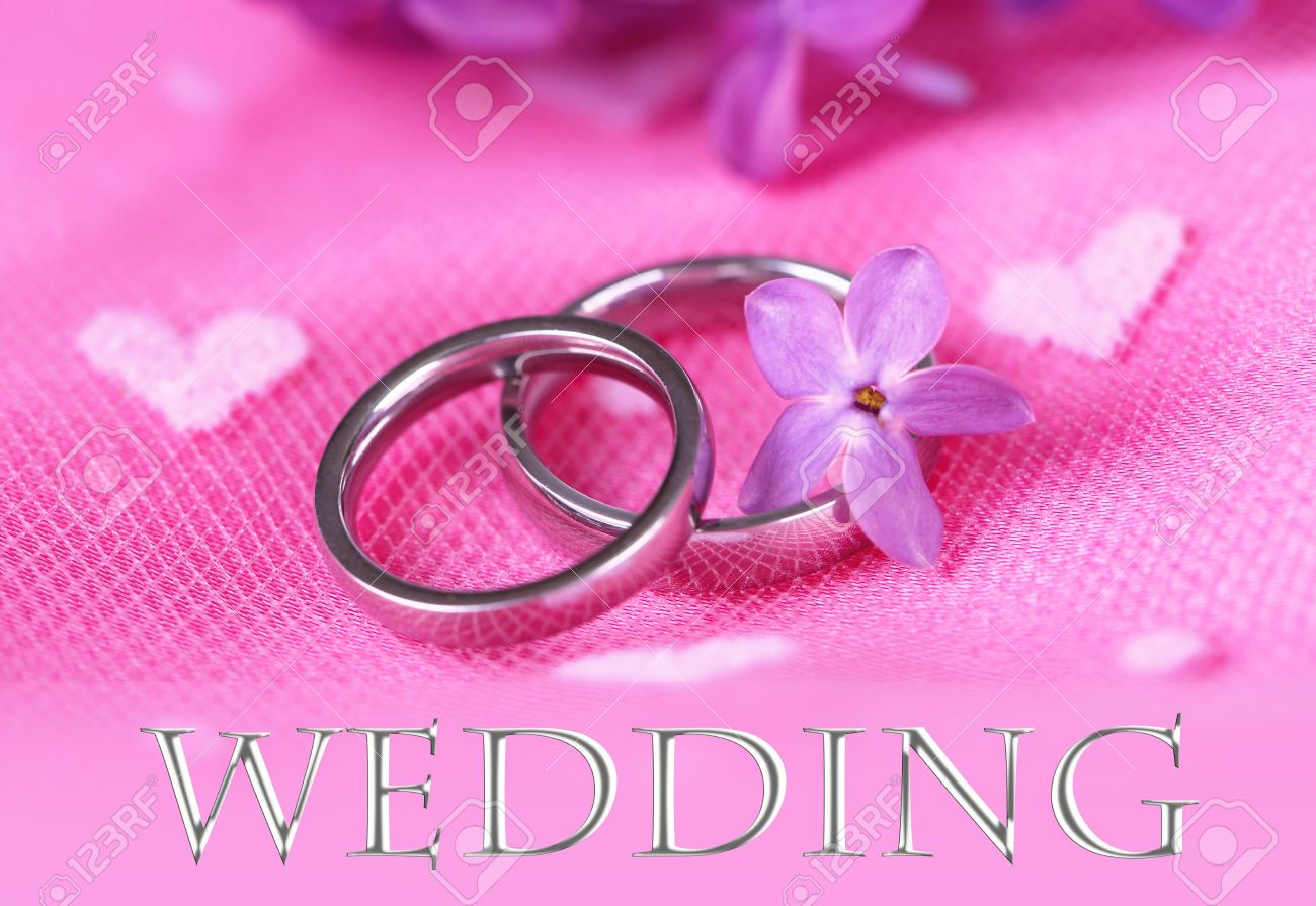 Beautiful Wedding Rings On Pink Background Stock Photo, Picture And ...