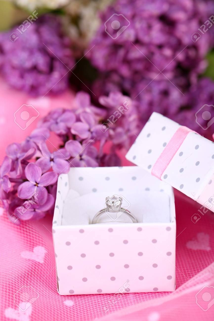 Beautiful Box With Wedding Ring On Purple Background Stock Photo ...