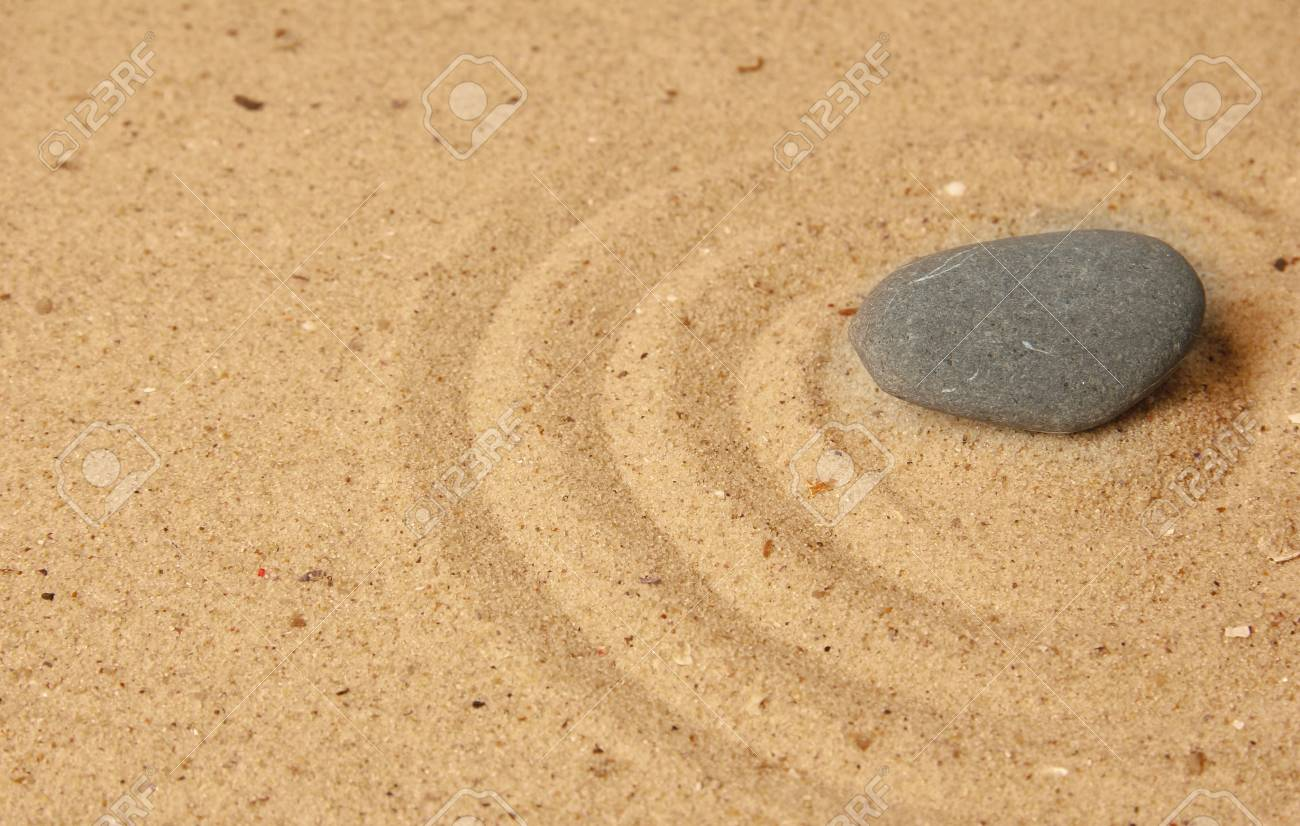 Zen garden with raked sand and stone close up Stock Photo - 20126702