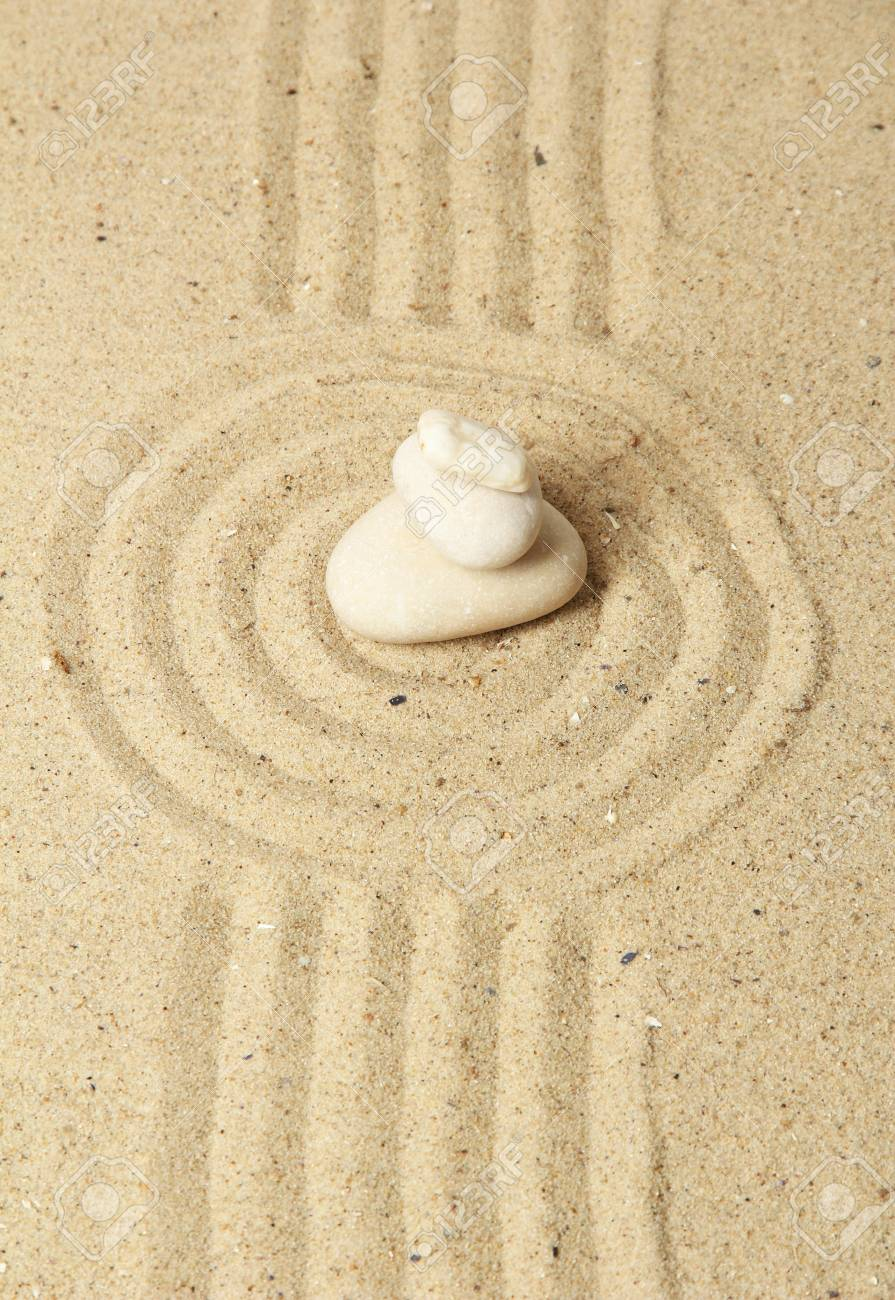 Zen garden with raked sand and round stones close up Stock Photo - 20257931
