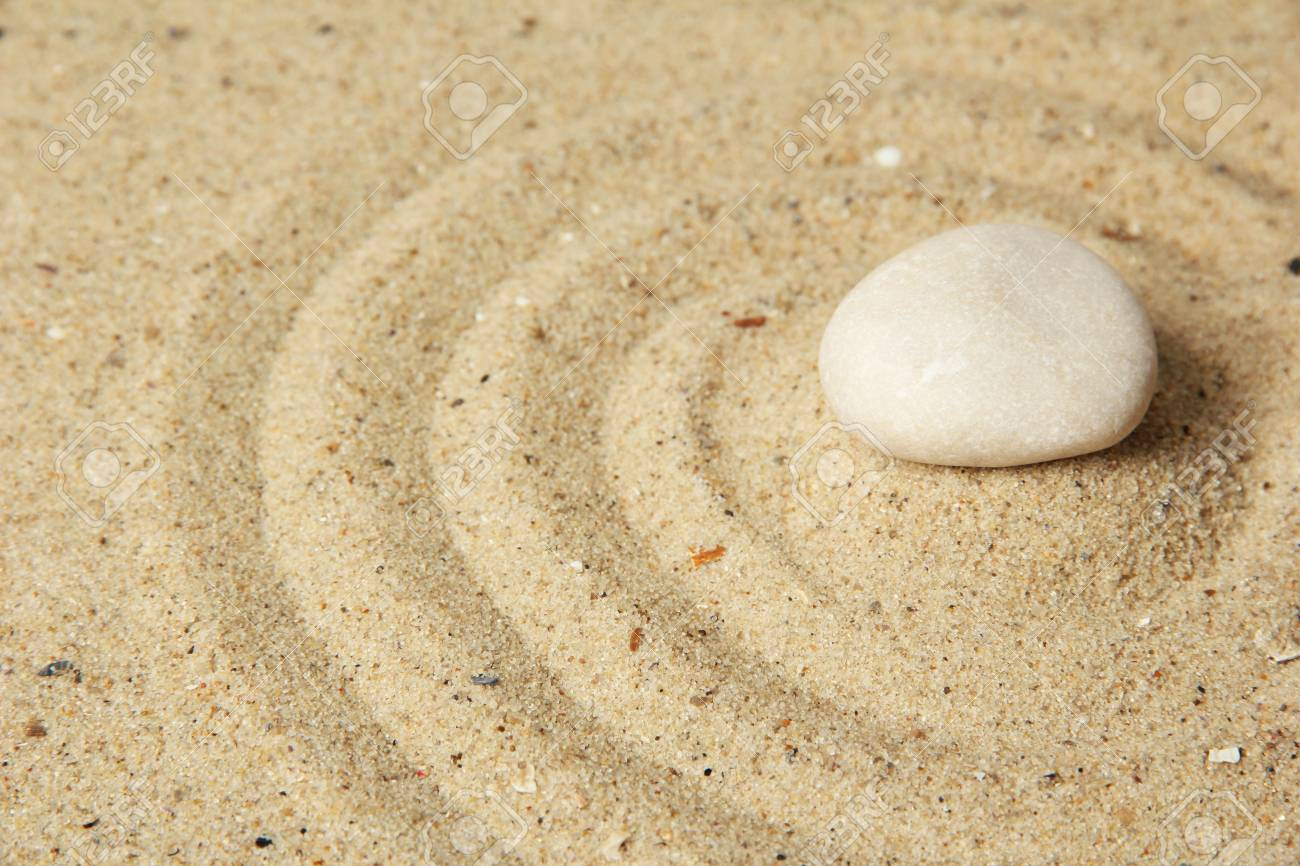 Zen garden with raked sand and stone close up Stock Photo - 20257839