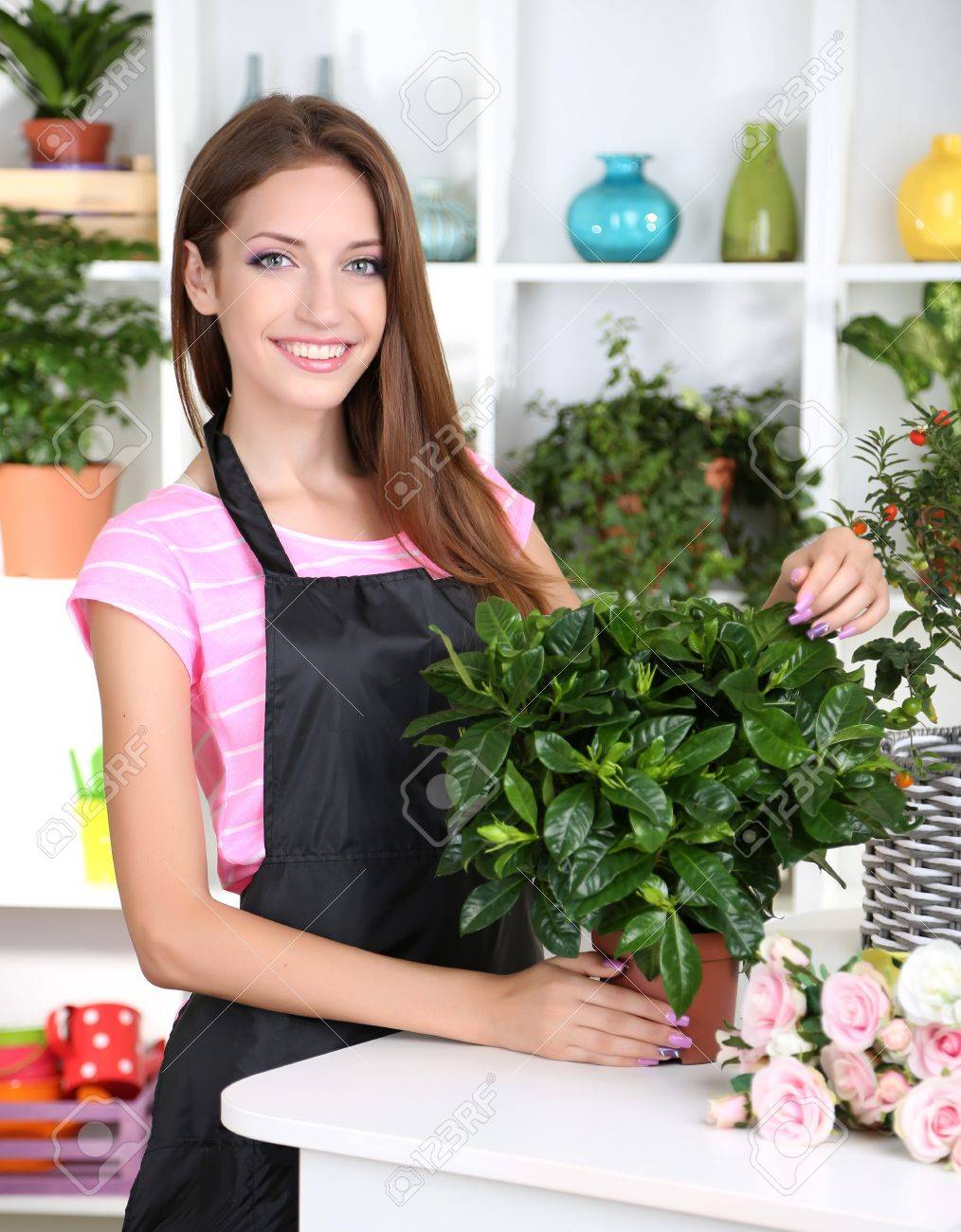 Beautiful girl florist with flowers in flowers shop Stock Photo - 21203993