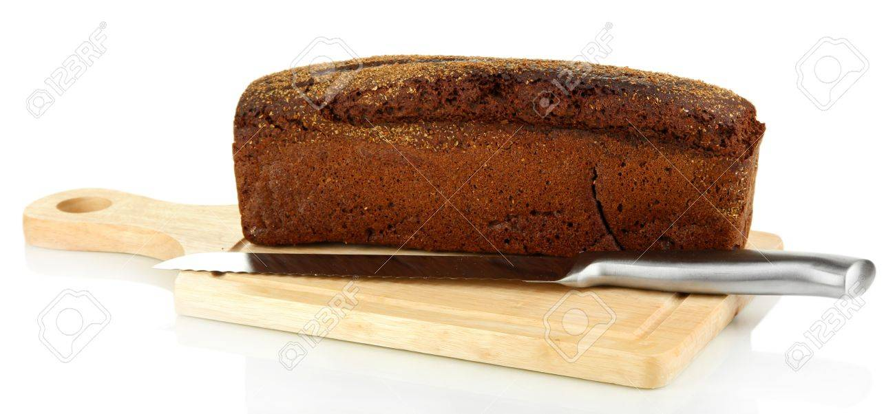 Black bread with sesame seeds and knife on wooden board isolated on white Stock Photo - 21247987