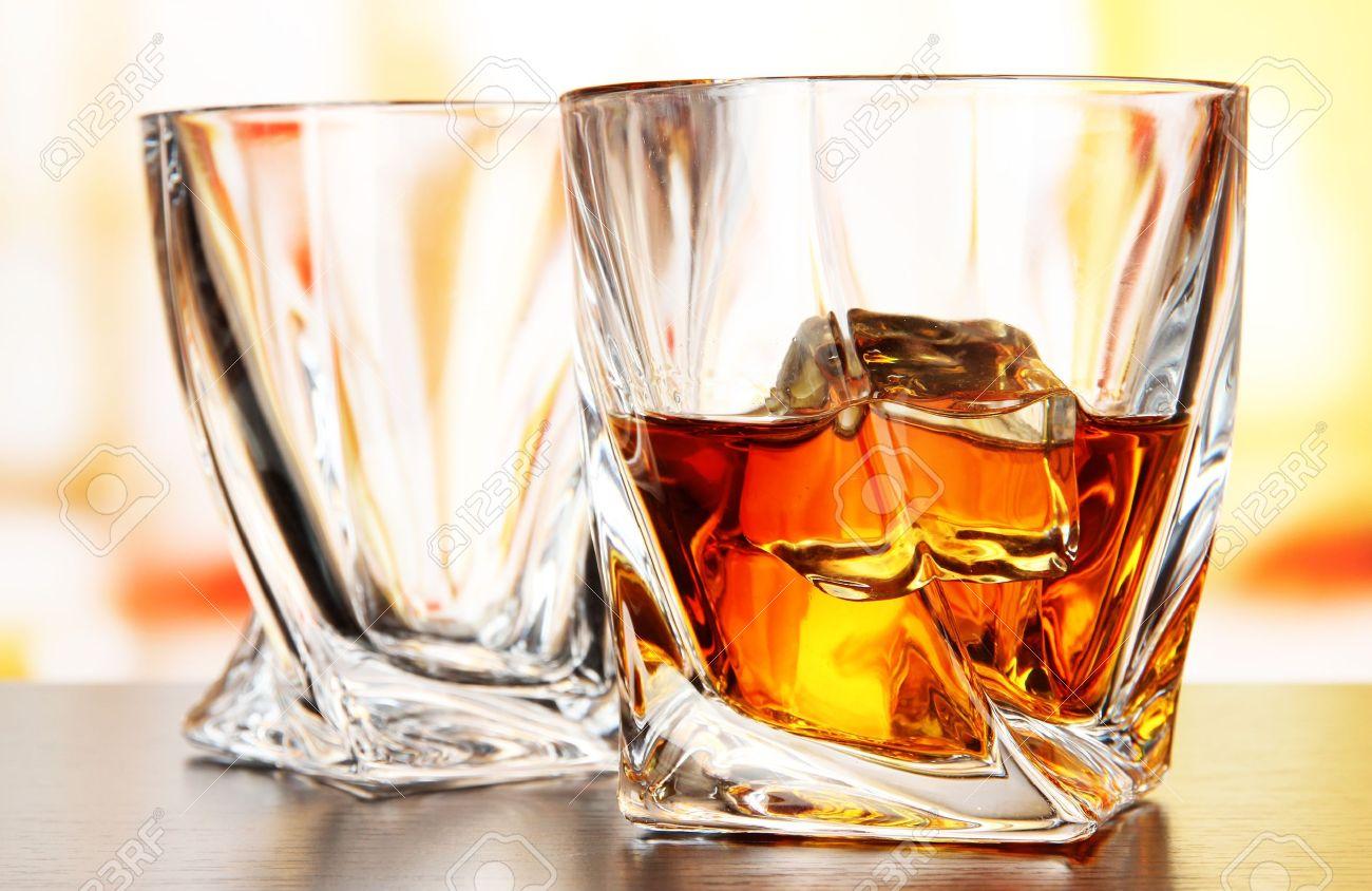 Glasses of whiskey, on bright background Stock Photo - 21322729