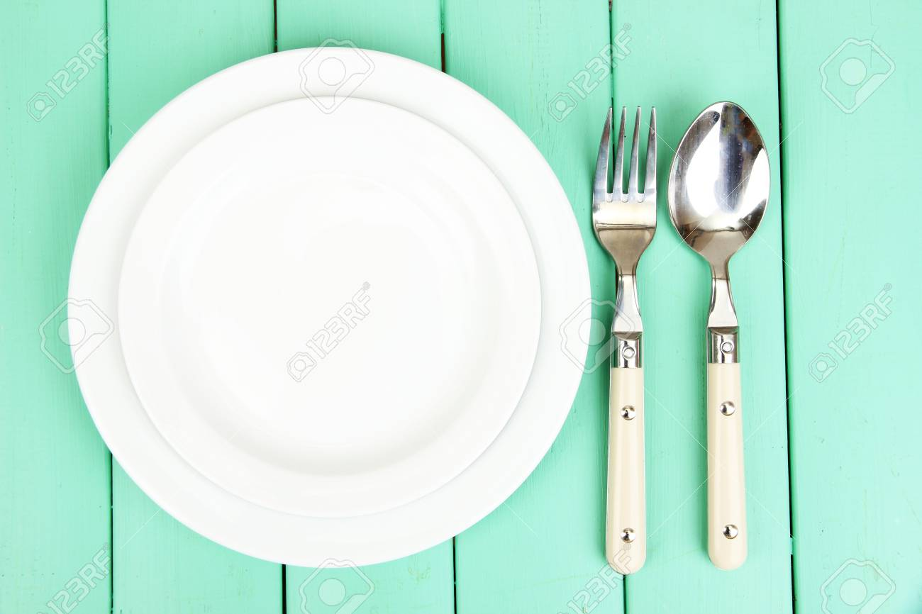 Plate and cutlery on wooden table close-up Stock Photo - 22342003