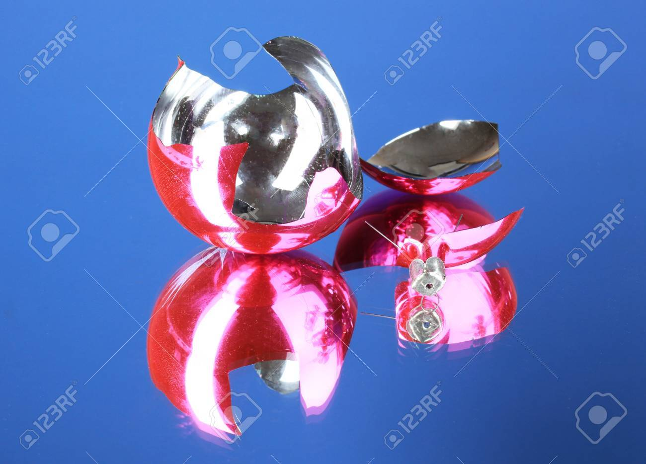 Broken Christmas Toy on blue background Stock Photo - 22858352