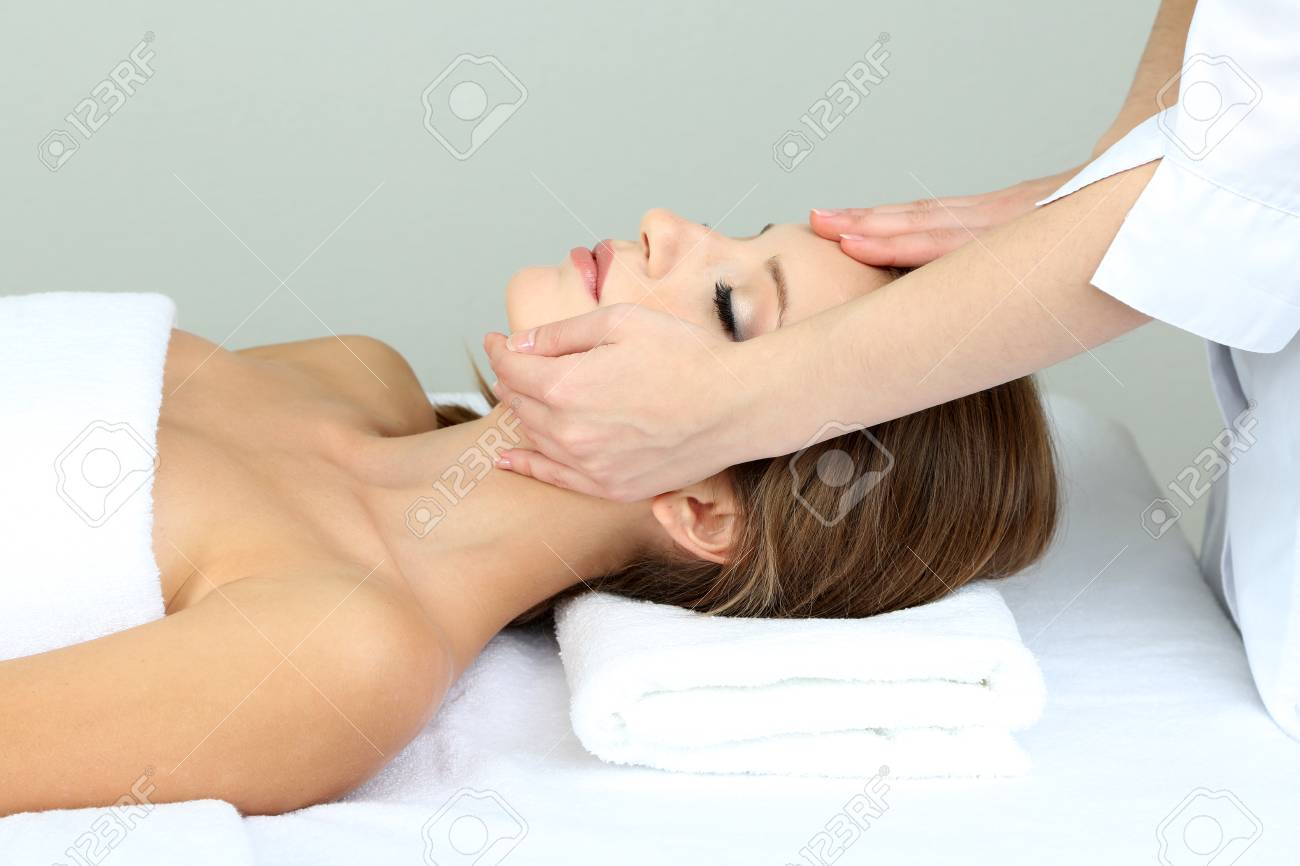 Beautiful young woman during facial massage in cosmetic salon close up Stock Photo - 24175036