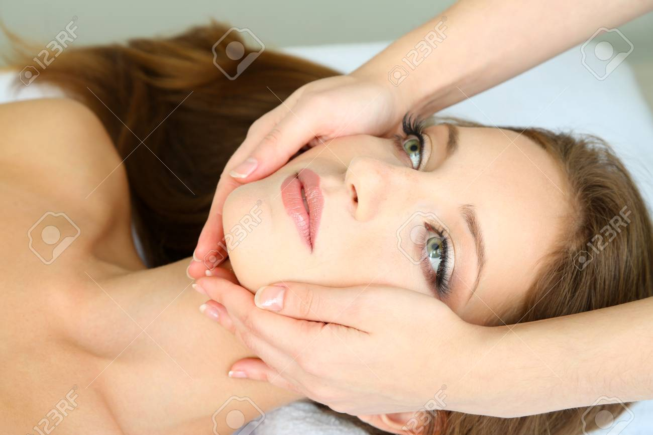 Beautiful young woman during facial massage in cosmetic salon close up Stock Photo - 24175296