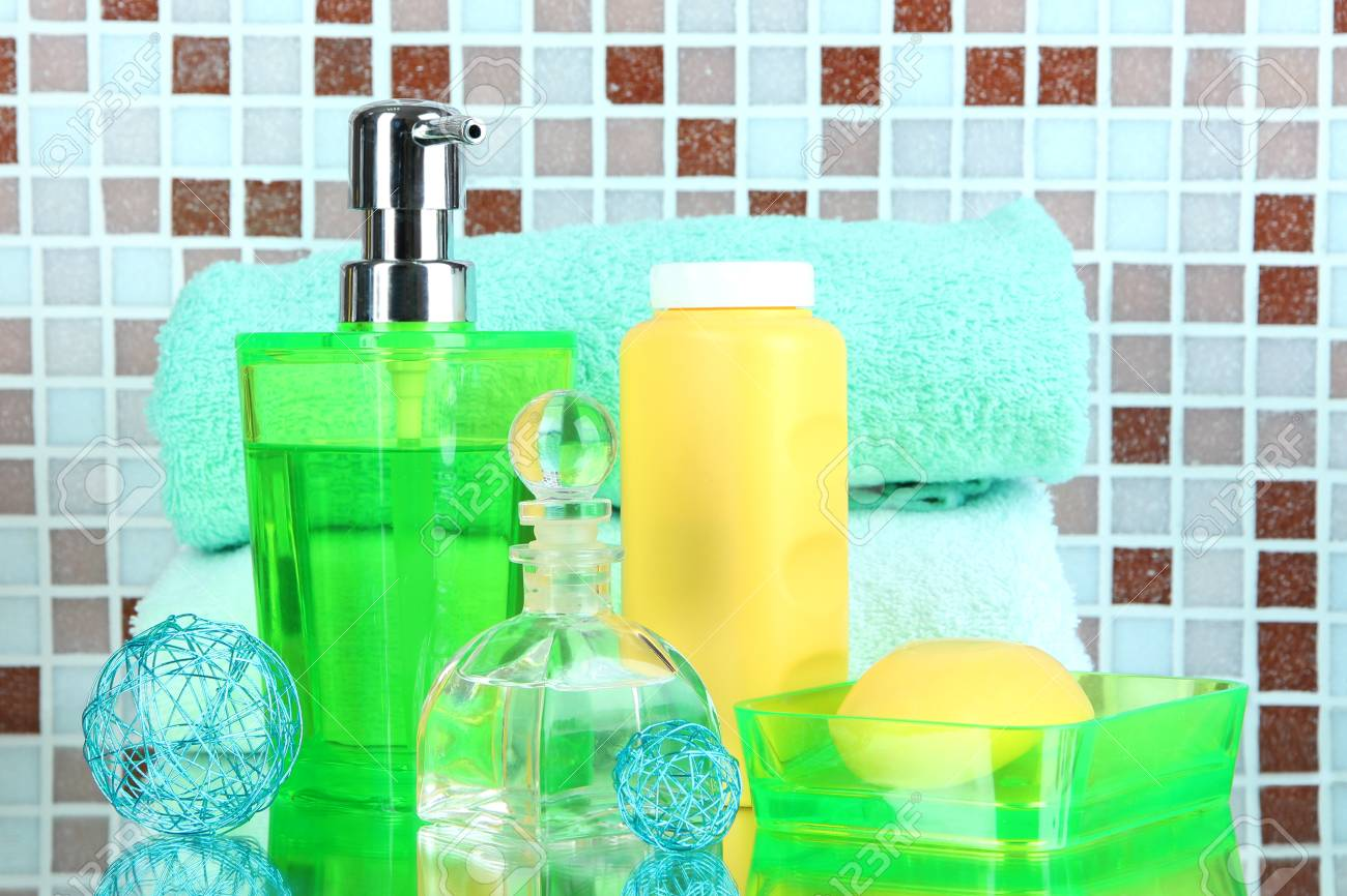 Cosmetics And Bath Accessories On Mosaic Tiles Background Stock ...