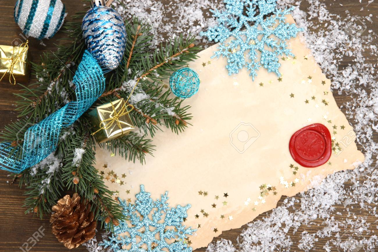Frame With Vintage Paper And Christmas Decorations On Wooden