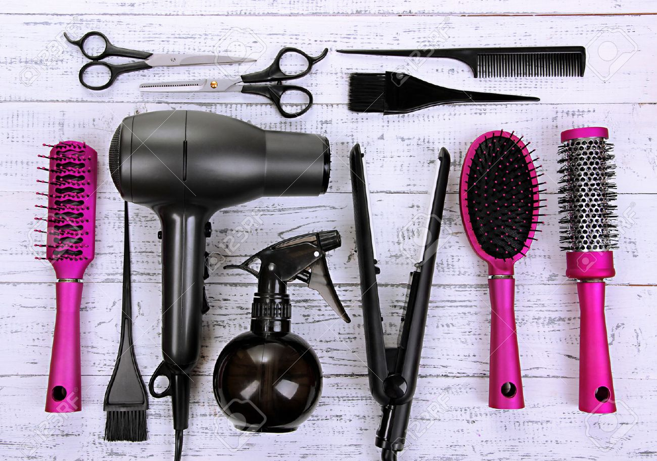 Hairdressing tools on white wooden table close-up Stock Photo - 24551892