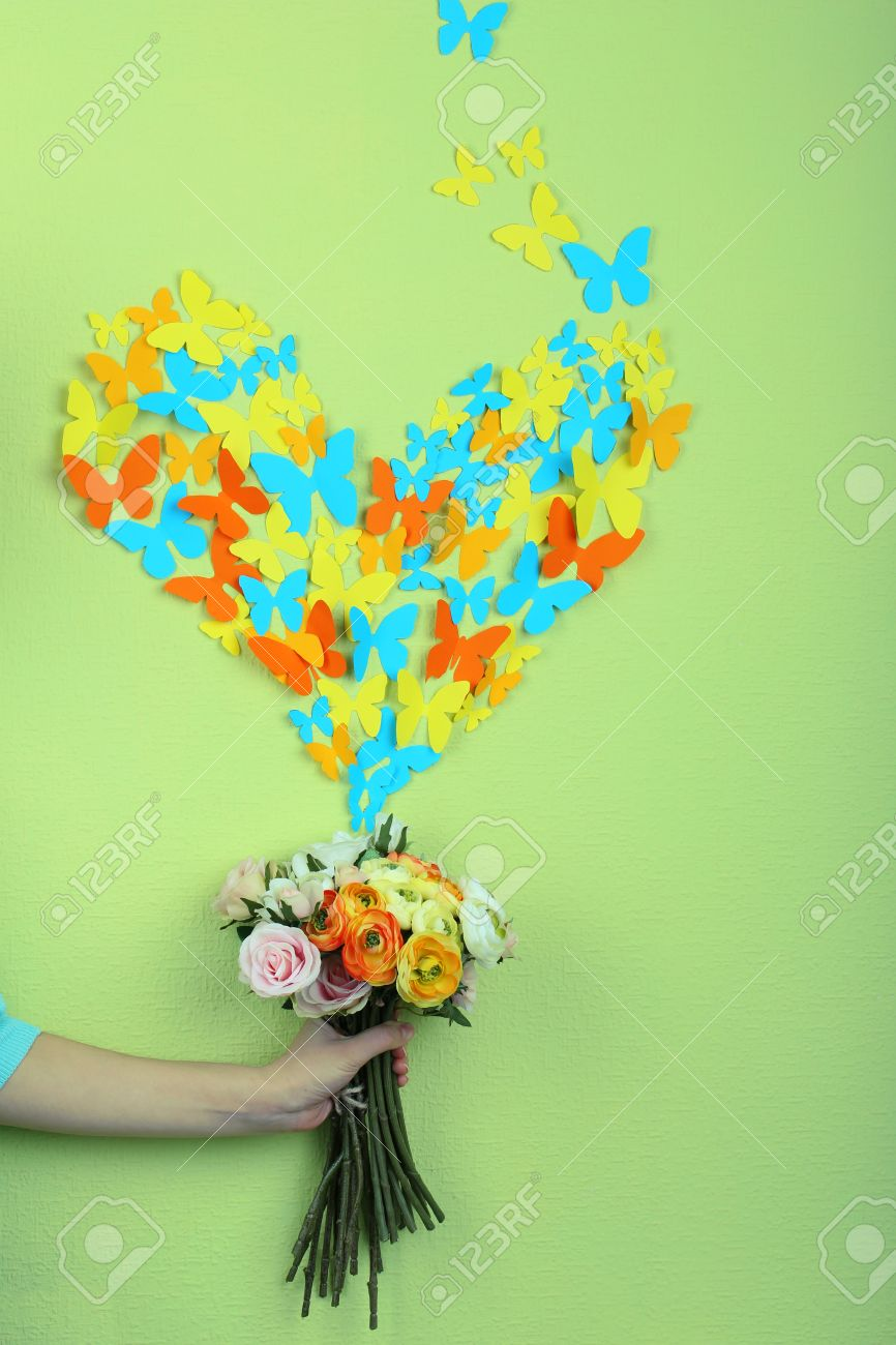 Paper Butterflies Fly Out Of Flowers On Green Wall Stock Photo