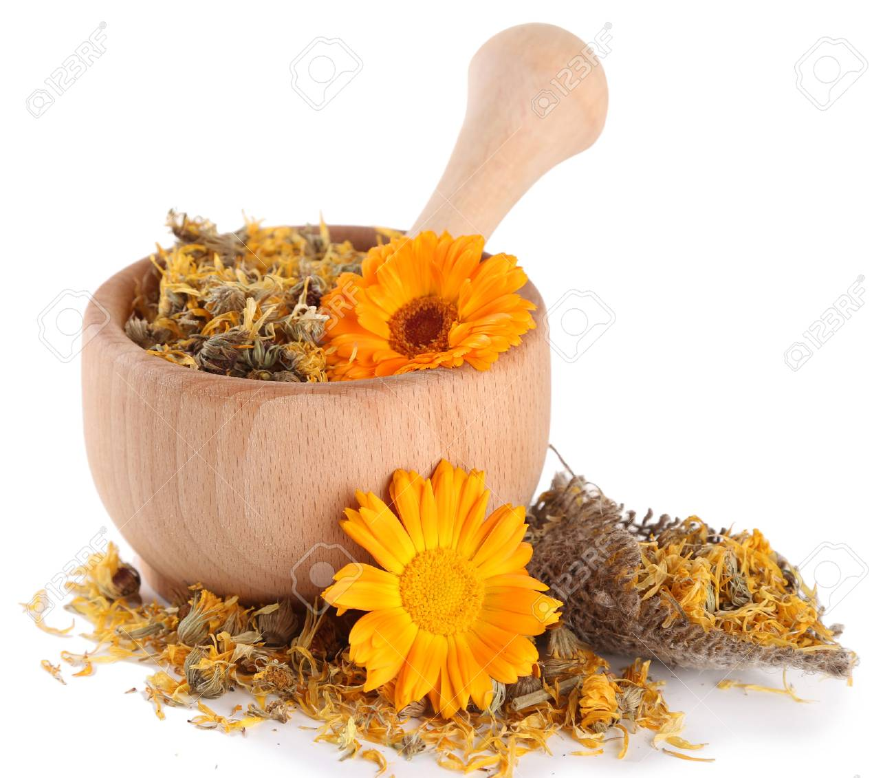 Fresh and dried calendula flowers in wooden mortar  isolated on white Stock Photo - 24864273
