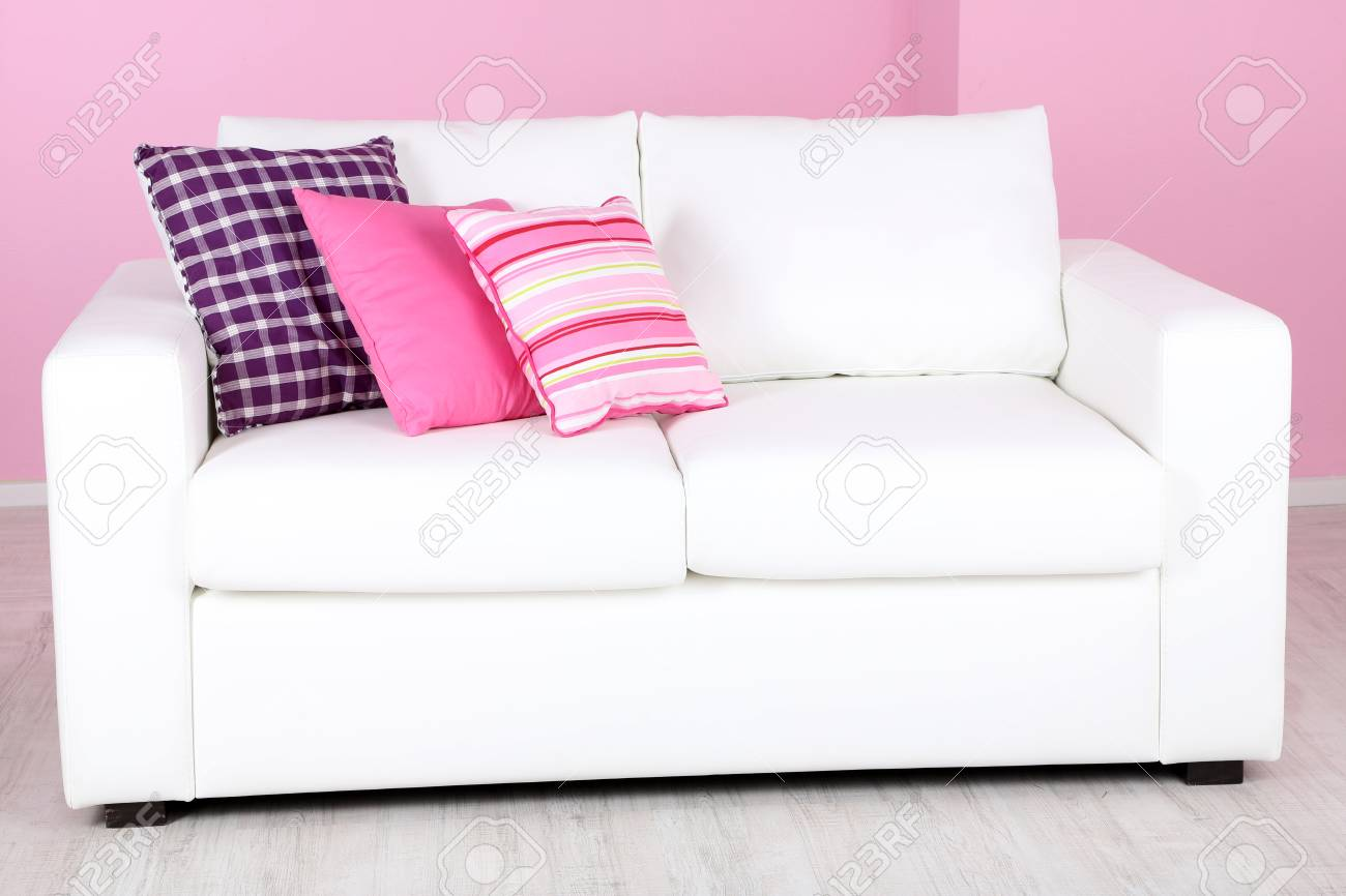 White sofa in room on pink background Stock Photo - 25317449