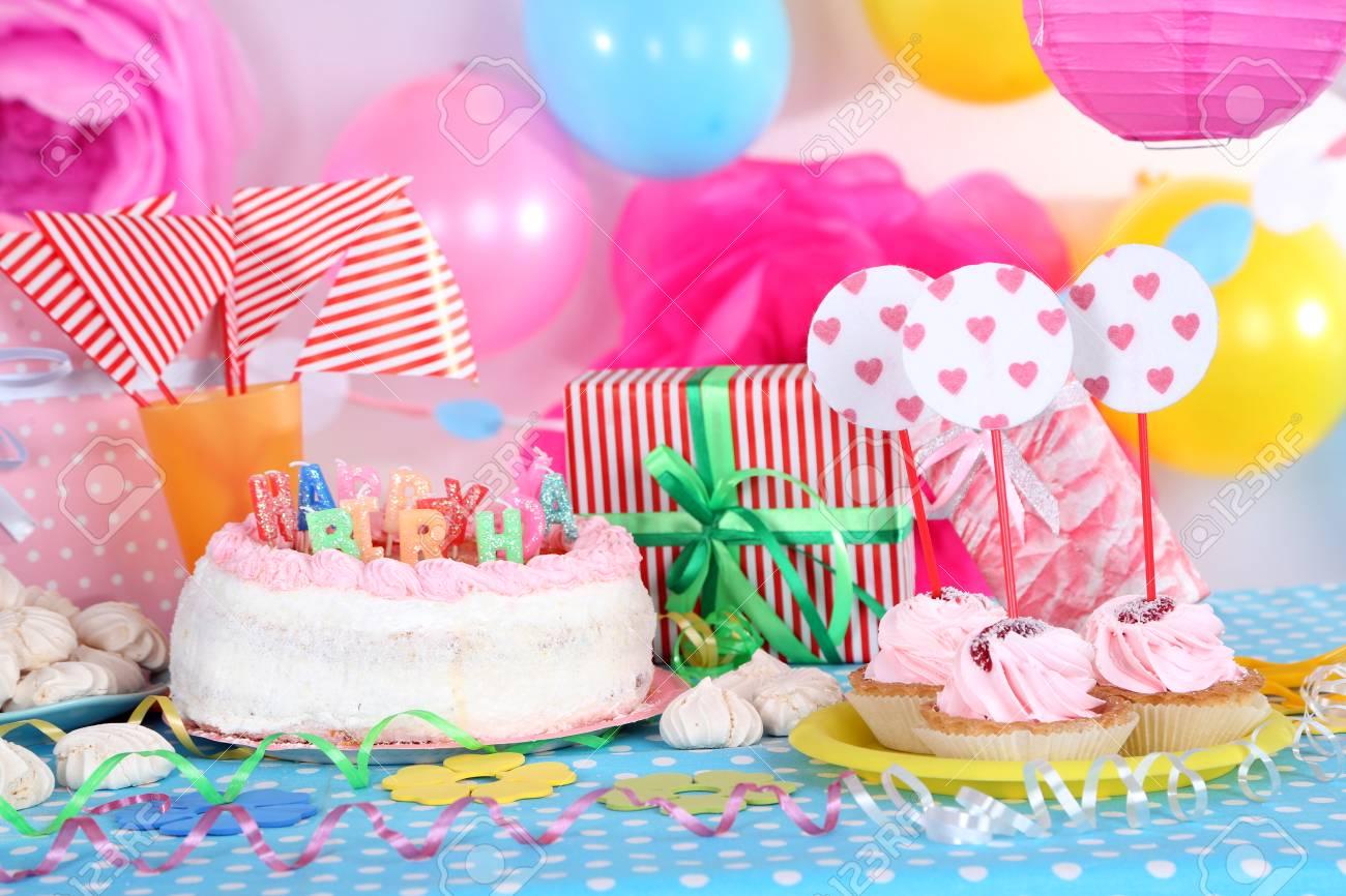 Festive Table Setting For Birthday On Celebratory Decorations Stock Photo