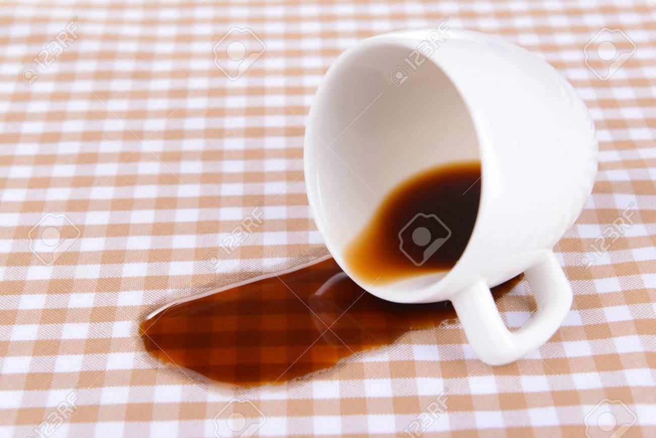 overturned cup of coffee on table close-up stock photo, picture
