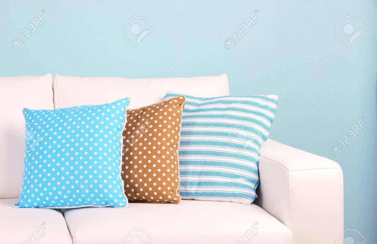 White sofa close-up in room on blue background Stock Photo - 27404743