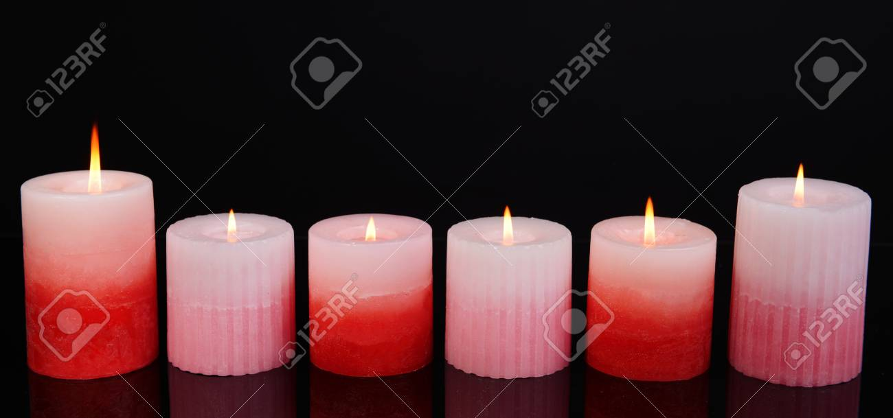 Beautiful Candles Isolated On Black Stock Photo Picture And