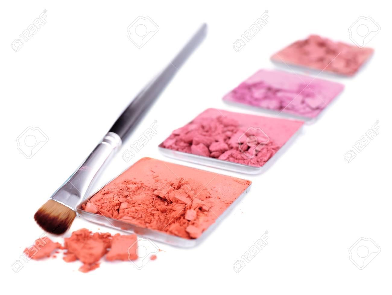 Crushed eyeshadow with brush isolated on white Stock Photo - 28339328