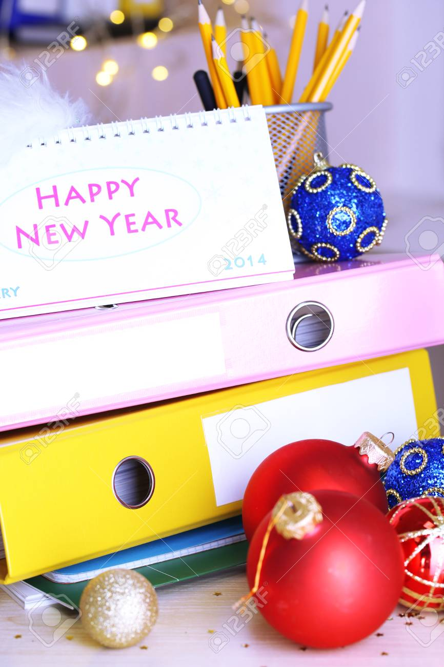 stock photo table with office supplies calendar and christmas tinsel close up - Office Supply Christmas Decorations