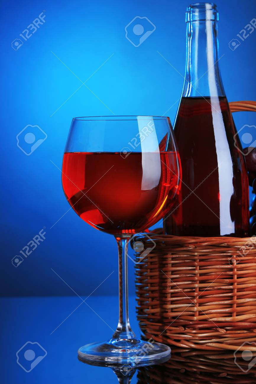 Ripe Grapes Wine Glass And Bottle Of Wine On Colorful Stock Photo