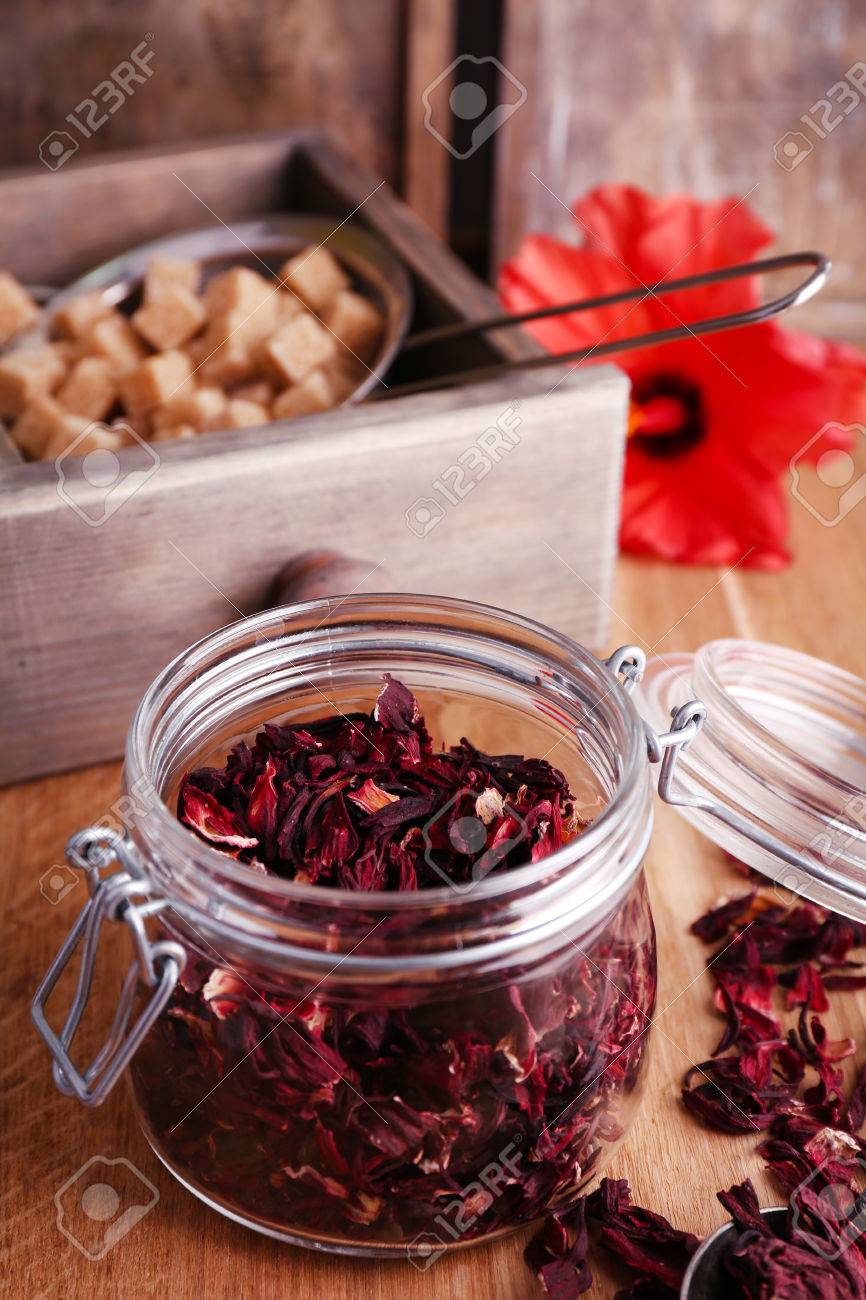 Dried hibiscus tea in glass jar fresh hibiscus flower and brown dried hibiscus tea in glass jar fresh hibiscus flower and brown sugar in box izmirmasajfo Images
