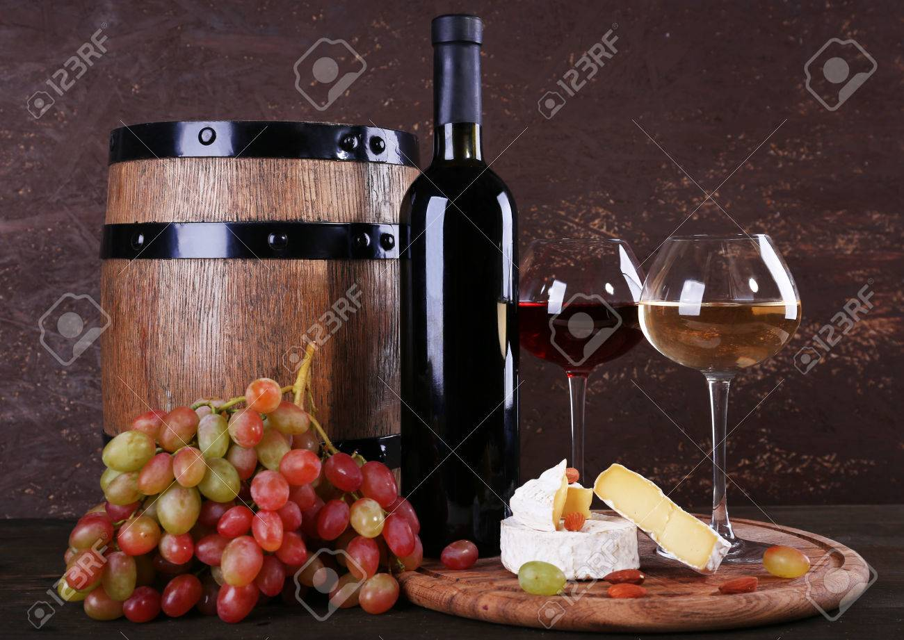 Supper Consisting Of Camembert Cheese Wine And Grapes On Cutting